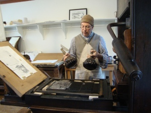 Printer Gary Gregory using the colonial Williamsburg press